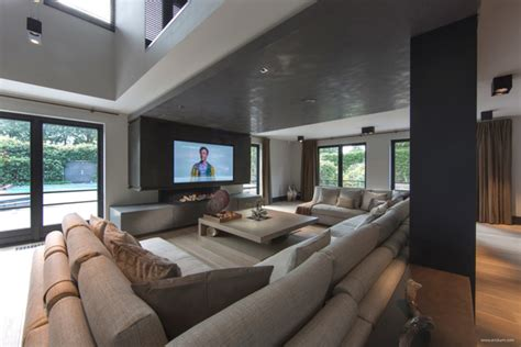 mansion living room with tv ultramodern sleek house with sharp lines Modern