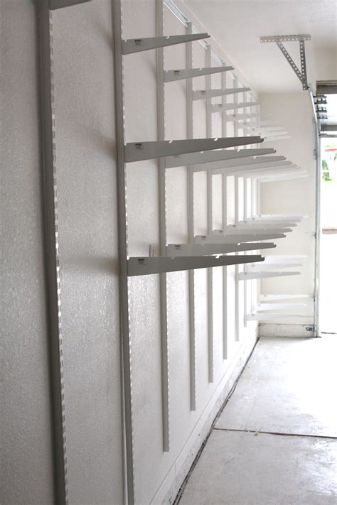 garage wall shelving simply done custom wall of garage shelving simply organized