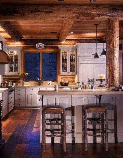log cabin kitchen cabinets log cabin kitchen i love the distressed white cabinets