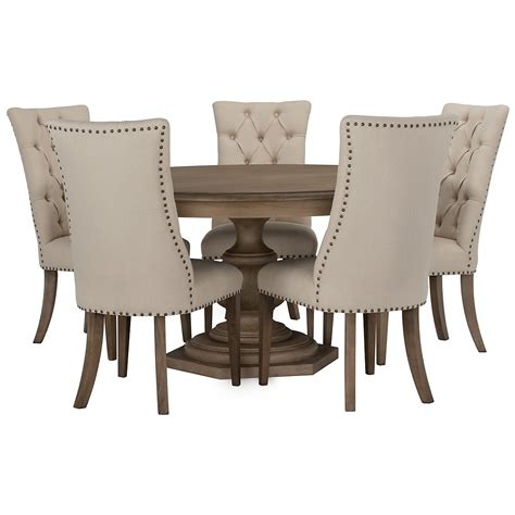 wood dining table with upholstered chairs city furniture haddie light tone round table 4