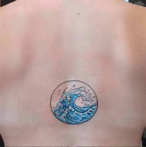 blue ink wave  circle frame tattoo  upper