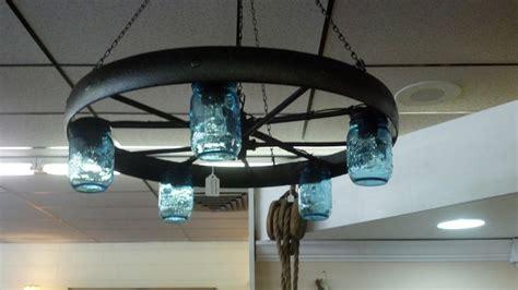 rustic cabin vintage wagon wheel chandelier blue jar