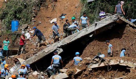 people dead  dozens missing  typhoon hits philippines