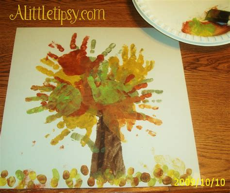 fall crafts for preschoolers finger painting fall handprint tree a little tipsy