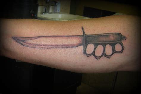black  grey knife tattoo  arm
