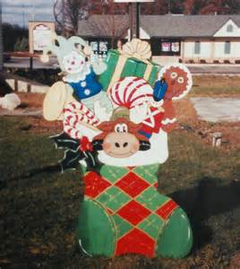 christmas stocking bursting with gifts outdoor wood by chardoman