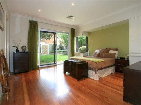 floorboard colours classic bedroom design idea with floorboards french doors using green colours bedroom photo