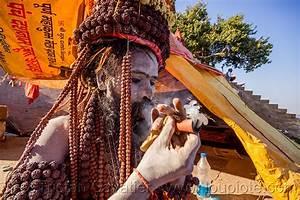sadhu smoking chillum on the ghats of varanasi