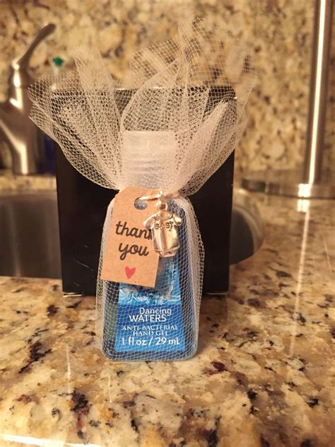 Hand sanitizer baby shower favor wrapped in tulle and tied