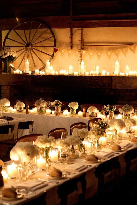 shabby chic wedding reception tablescape for a wedding reception with a barn as the party venue shabby chic party decor