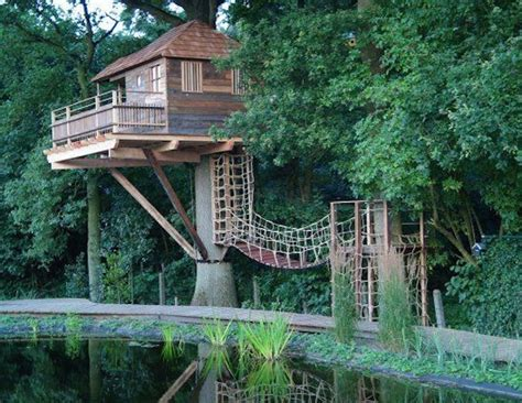 House In Tree by 12 Treehouses That Give Us Major Wanderlust Inhabitots