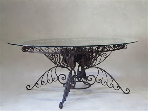 oval wrought iron patio table lake house plans sloping lot