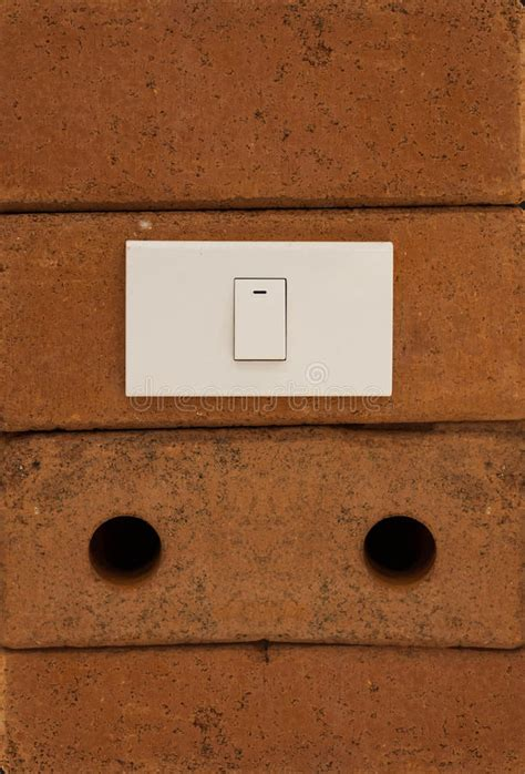 light switch on red brick wall image 44847530
