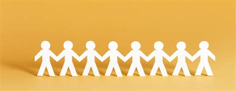 paper people standing   row holding hands banner