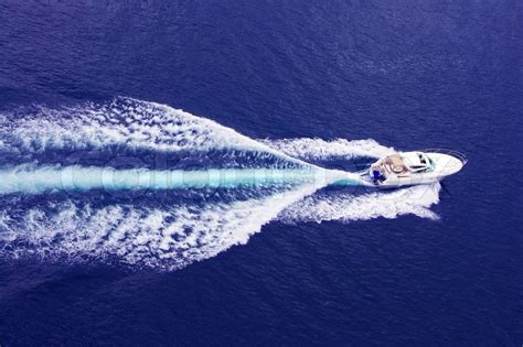 Fast Wake Boats by Fast Motor Boat With Splash And Wake Stock Photo Colourbox