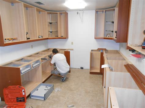 how to hang cabinets how to install kitchen wall and base cabinets builder