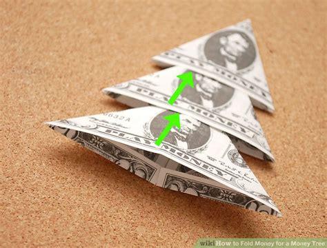 fold dollar into christmas tree 3 ways to fold money for a money tree wikihow