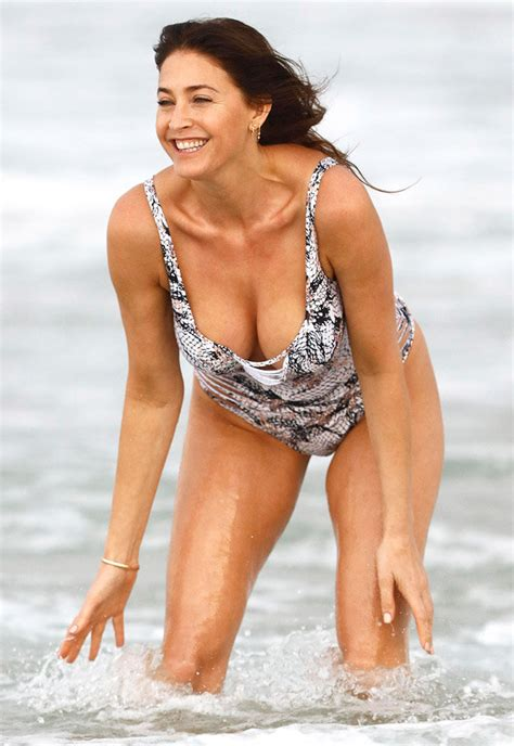 lisa swimsuit lisa snowdon flaunts boob and booty in slashed snake
