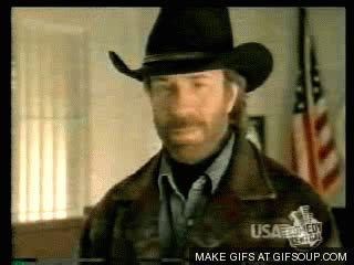 chuck norris stops chainsaw the 20 awesomest chuck norris gifs