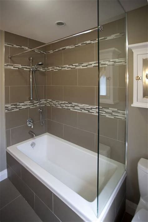 a tempered glass wall provides support for the shower