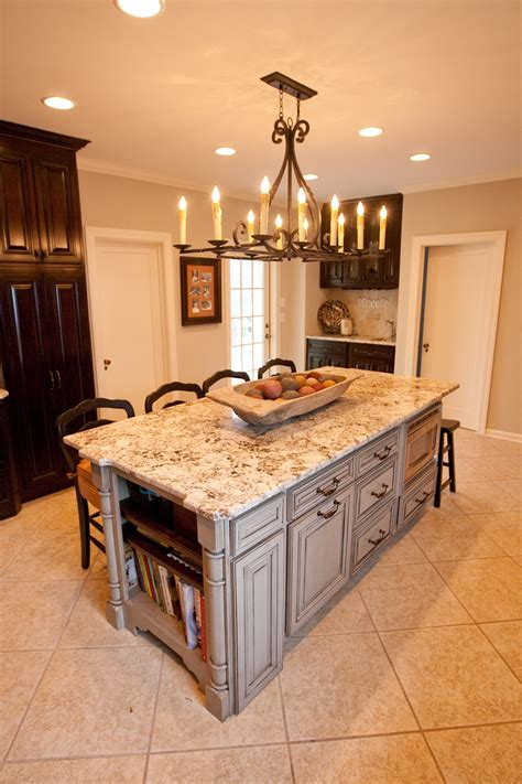 Rustic Chandelier Over White Marble Top Kitchen Island