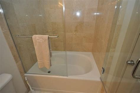 Corner Soaker Tub Shower Combo by Bathroom Soaker Tub Shower Combo With Folding Glass