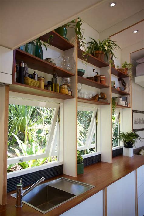 small homes interior design photos bed automatically retracts up high in this contemporary