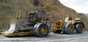 cat d11 cat 777 haul truck moving a cat d11 on a tilt deck heavy