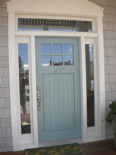 mid century rocking blue front door color for brick house mixed with