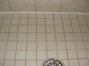 Kera bath shower inc tile versus cultured marble for Cracked bathroom tile repair