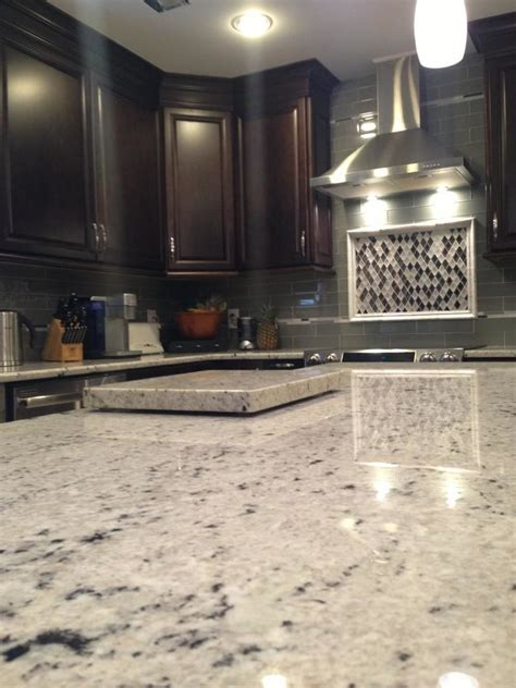 Kitchen Island And Breakfast Bar - colonial white granite spaces traditional with none none