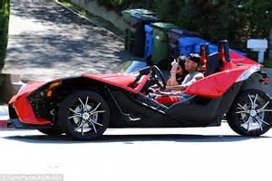 Kylie Jenner Enjoys A Ride In Boyfriend Tyga's Three Wheel
