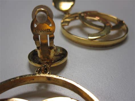 chanel gold tone double  logo earrings  stdibs