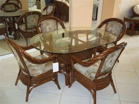 oval glass top dining table with rattan chairs