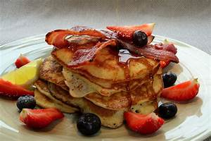 Pancake Stack With Crisp Bacon  Blueberries  Strawberries