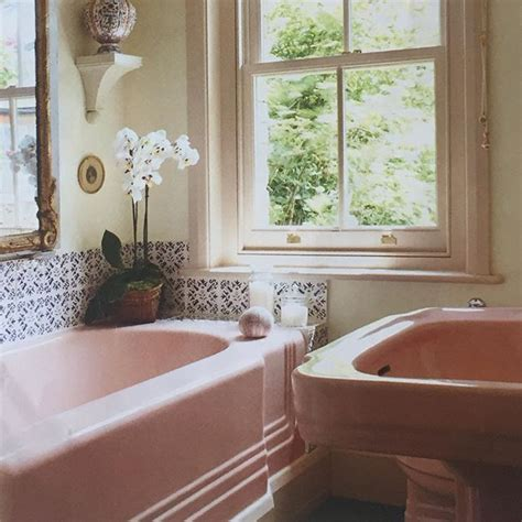 pink bathroom suite with blue white tiles from