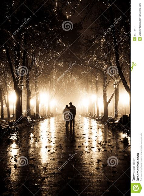 couple walking  alley  night lights royalty