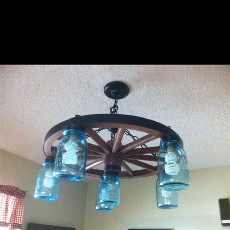 wagon wheel light with mason jars wagon wheel and mason jar light craft ideas pinterest