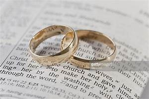 wedding rings on top of an open bible stock photo getty With is wedding ring biblical