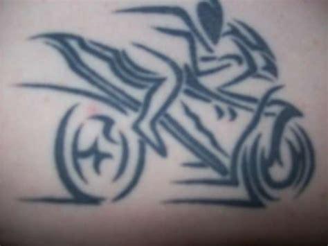 tribal motorbike tattoo