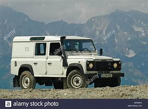 White Land Rover Defender 110 Station Wagon Td5 In The
