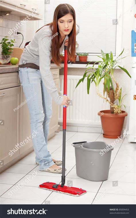 mop kitchen floor holding mop cleaning kitchen floor stock photo 4274