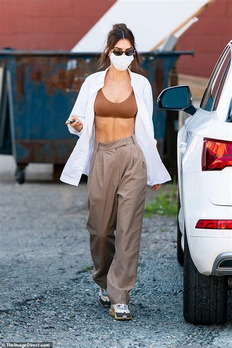 Emily Ratajkowski looks chic in bra top and khaki trousers