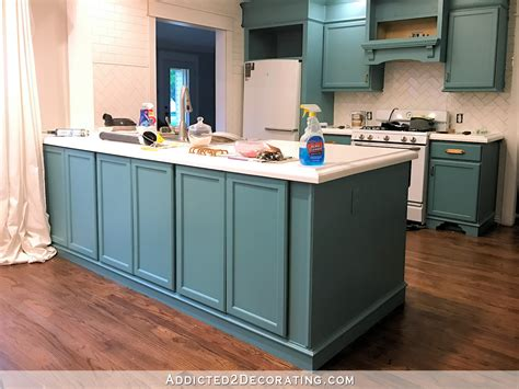 freshly painted teal kitchen cabinets