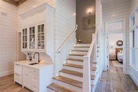 beach bungalow wet bar   staircase cottage kitchen