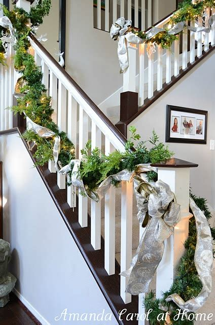stairway garland perfect garland on the staircase holiday decor pinterest