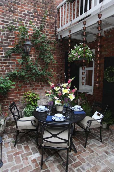 New Patio by Cozy Brick Patio With Espaliered Wall Looks Like A