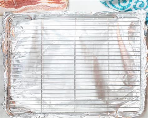 bacon oven baking sheet rimmed rack foil lined arrange step cook lay