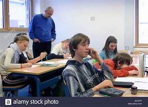 teenager talking on his mobile phone during class Stock ...