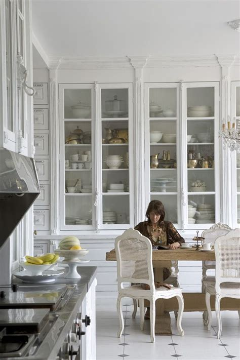 tall kitchen cabinets with glass doors french traditional white kitchen countertop cabinet locks